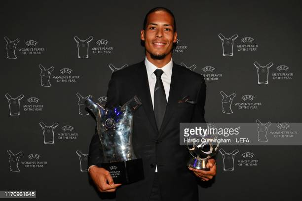 Virgil van Dijk of Liverpool poses with the UEFA Champions League Defender of the Season 2018/19 and UEFA Men's Player of the Year 2018/19 Awards...