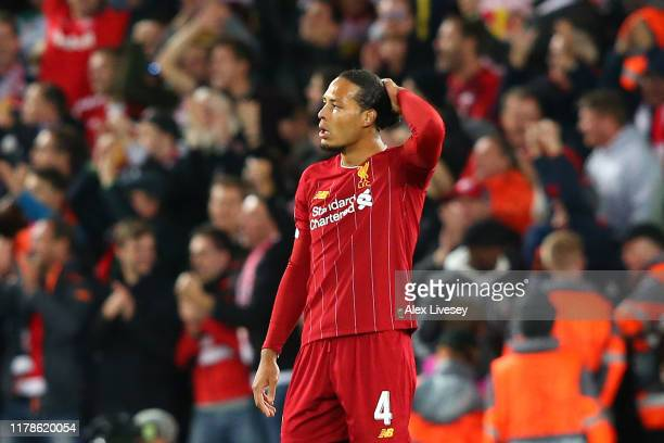 Virgil van Dijk of Liverpool reacts after Salzburg score their third goal during the UEFA Champions League group E match between Liverpool FC and RB...