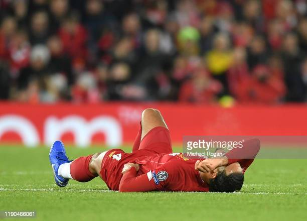 Virgil van Dijk of Liverpool reacts with an injury during the UEFA Champions League group E match between Liverpool FC and SSC Napoli at Anfield on...