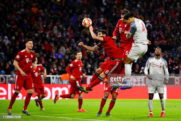 Virgil van Dijk of Liverpool scores his sides second goal during the UEFA Champions League Round of 16 Second Leg match between FC Bayern Muenchen...
