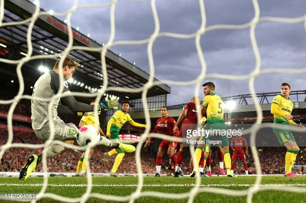 Virgil van Dijk of Liverpool scores his sides third goal during the Premier League match between Liverpool FC and Norwich City at Anfield on August...