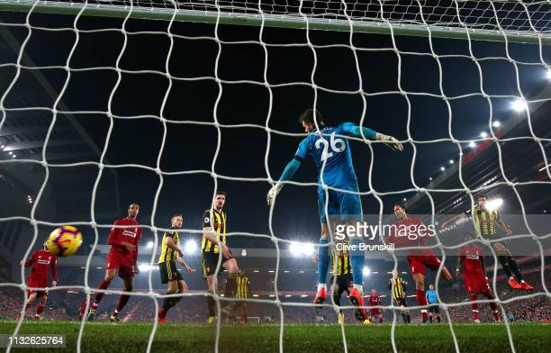 Virgil van Dijk of Liverpool scores his team's fifth goal past Ben Foster of Watford during the Premier League match between Liverpool FC and Watford...