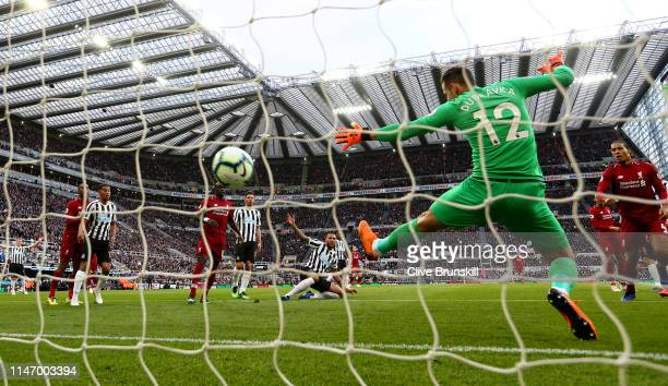 Virgil van Dijk of Liverpool scores his team's first goal during during the Premier League match between Newcastle United and Liverpool FC at St...