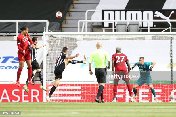 Virgil van Dijk of Liverpool scores his team's first goal during the Premier League match between Newcastle United and Liverpool FC at St. James Park...