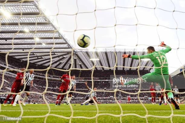 Virgil van Dijk of Liverpool scores his team's first goal past Martin Dubravka of Newcastle United during the Premier League match between Newcastle...