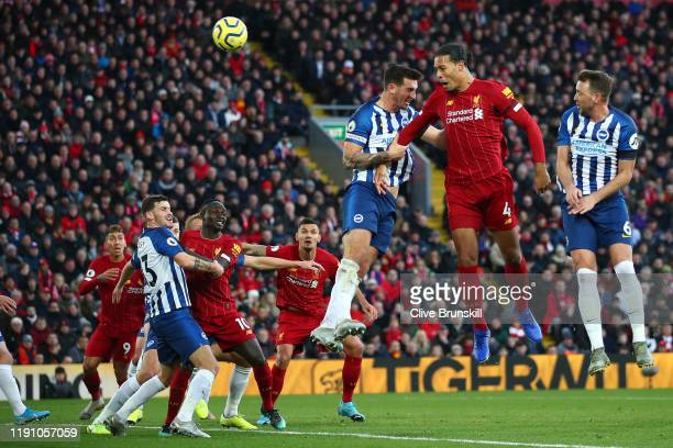 Virgil van Dijk of Liverpool scores his teams first goal with header during the Premier League match between Liverpool FC and Brighton Hove Albion at...