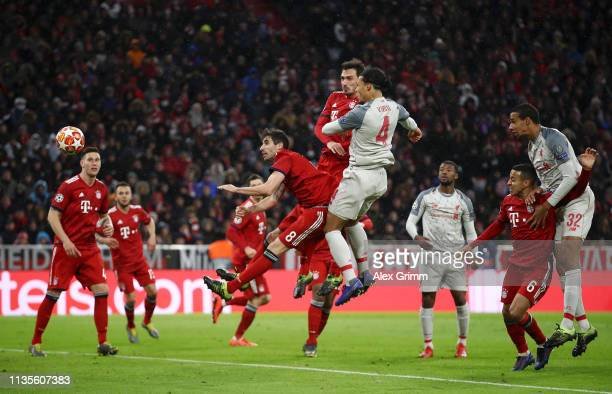 Virgil van Dijk of Liverpool scores his team's second goal during the UEFA Champions League Round of 16 Second Leg match between FC Bayern Muenchen...