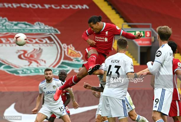 Virgil van Dijk of Liverpool scores his team's second goal during the Premier League match between Liverpool and Leeds United at Anfield on September...