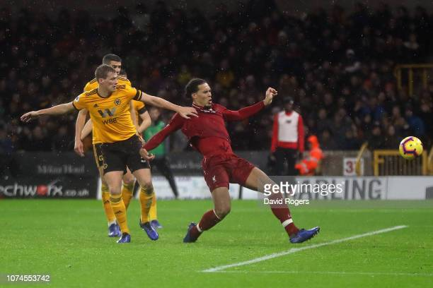 Virgil van Dijk of Liverpool scores his team's second goal of the game during the Premier League match between Wolverhampton Wanderers and Liverpool...