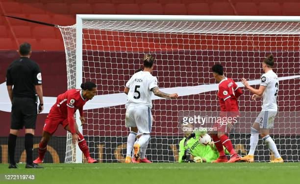 Virgil van Dijk of Liverpool scores his team's second goal past Illan Meslier of Leeds United during the Premier League match between Liverpool and...