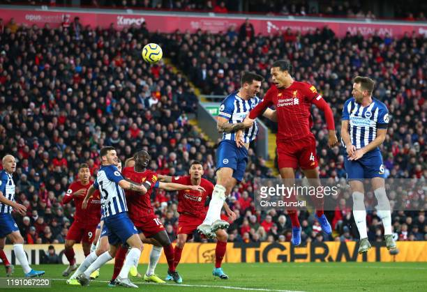 Virgil van Dijk of Liverpool scores his teams second goal with header during the Premier League match between Liverpool FC and Brighton Hove Albion...
