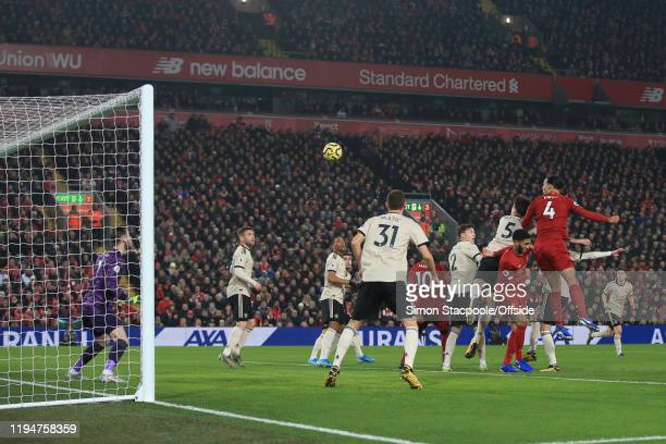 Virgil van Dijk of Liverpool scores their 1st goal during the Premier League match between Liverpool FC and Manchester United at Anfield on January...