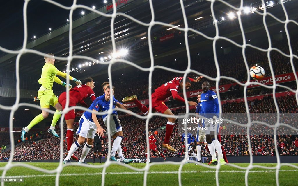 Virgil van Dijk of Liverpool (2L) scores their second goal past goalkeeper Jordan Pickford of Everton (1) during the Emirates FA Cup Third Round match between Liverpool and Everton at Anfield on January 5, 2018 in Liverpool, England.