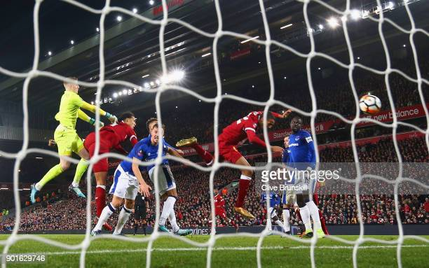 Virgil van Dijk of Liverpool scores their second goal past goalkeeper Jordan Pickford of Everton during the Emirates FA Cup Third Round match between...