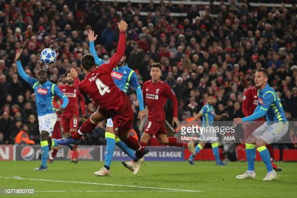 Virgil van Dijk of Liverpool sends a shot over the bar during the UEFA Champions League Group C match between Liverpool and SSC Napoli at Anfield on...