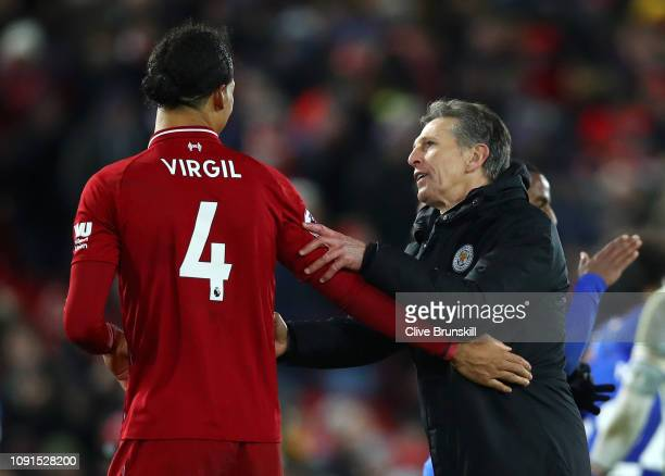 Virgil van Dijk of Liverpool shakes hands with Claude Puel Manager of Leicester City after the Premier League match between Liverpool FC and...