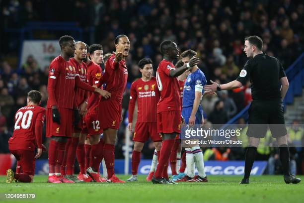 Virgil van Dijk of Liverpool shouts at referee Chris Kavanagh from the defensive wall during the FA Cup Fifth Round match between Chelsea and...