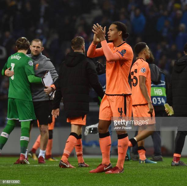 Virgil van Dijk of Liverpool shows his appreciation to the fans at the end of the UEFA Champions League Round of 16 First Leg match between FC Porto...