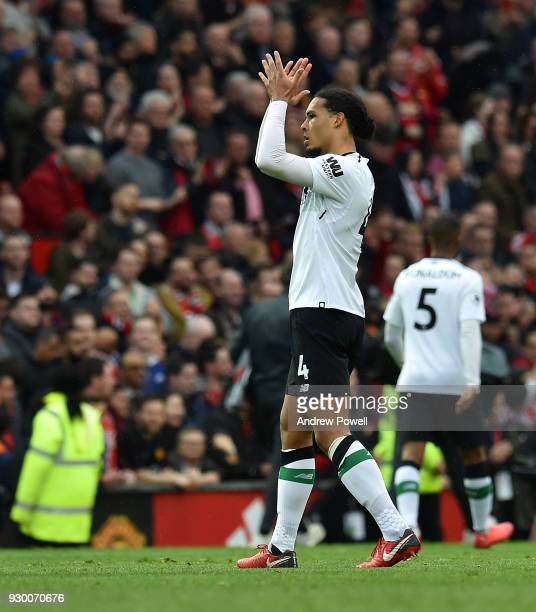Virgil van Dijk of Liverpool shows his appreciation to the fans at the end of the Premier League match between Manchester United and Liverpool at Old...