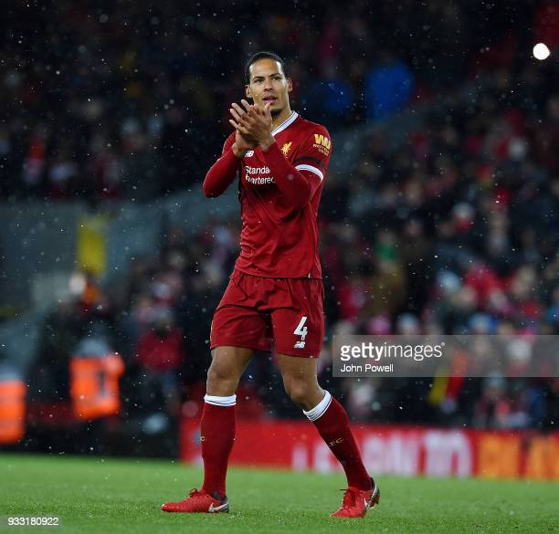 Virgil van Dijk of Liverpool shows his appreciation to the fans at the end of the Premier League match between Liverpool and Watford at Anfield on...