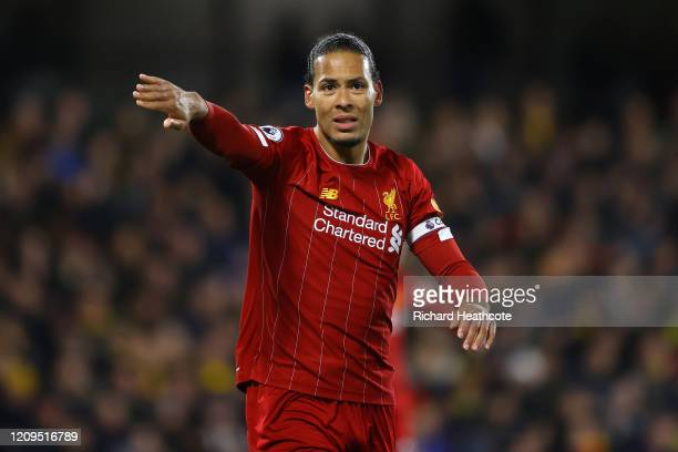 Virgil van Dijk of Liverpool signals to a team mate during the Premier League match between Watford FC and Liverpool FC at Vicarage Road on February...