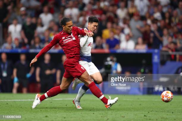 Virgil van Dijk of Liverpool tackles HeungMin Son of Tottenham Hotspur during the UEFA Champions League Final between Tottenham Hotspur and Liverpool...