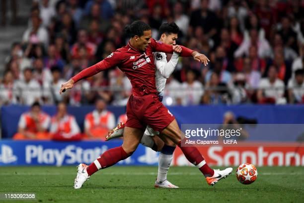 Virgil van Dijk of Liverpool tackles HeungMin Son of Tottenham Hotspur during the UEFA Champions League Final between Tottenham Hotspur and Liverpool...