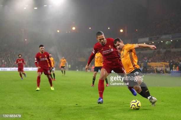 Virgil van Dijk of Liverpool tackles Jonny Castro of Wolverhampton Wanderers during the Premier League match between Wolverhampton Wanderers and...