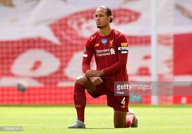 Virgil van Dijk of Liverpool takes a knee in support of the Black Lives Matter movement during the Premier League match between Liverpool FC and...