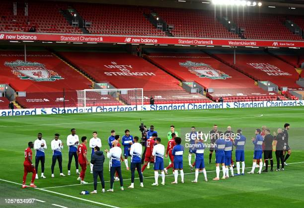 Virgil van Dijk of Liverpool walks his team through a guard of honour from Chelsea players prior to the Premier League match between Liverpool FC and...