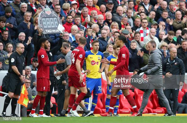 Virgil van Dijk of Liverpool walks off as he is substituted for teammate Joe Gomez during the Premier League match between Liverpool FC and...