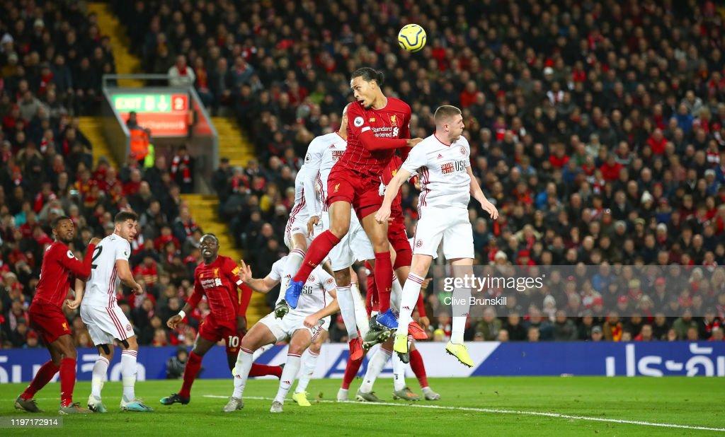 Virgil Van Dijk Of Liverpool Wins A Header Over John Lundstram Of News Photo Getty Images