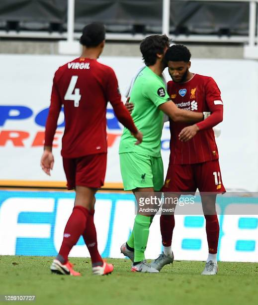 Virgil van Dijk of Liverpool with Alisson Becker of Liverpool and Joe Gomez of Liverpool during the Premier League match between Newcastle United and...