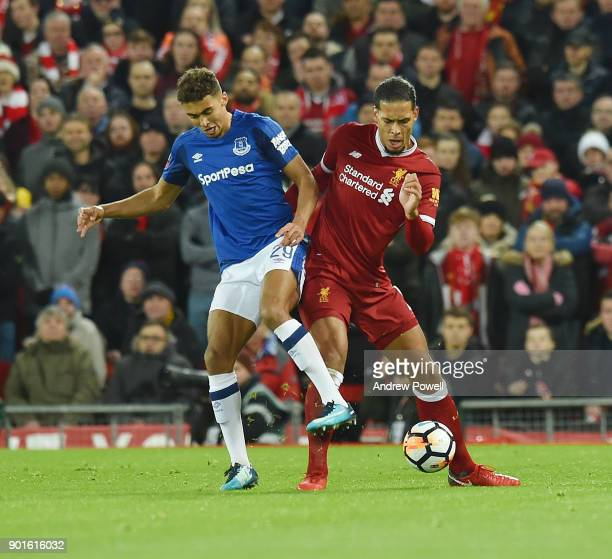Virgil van Dijk of Liverpool with Dominic CalvertLewin of Everton during The Emirates FA Cup Third Round match between Liverpool and Everton at...