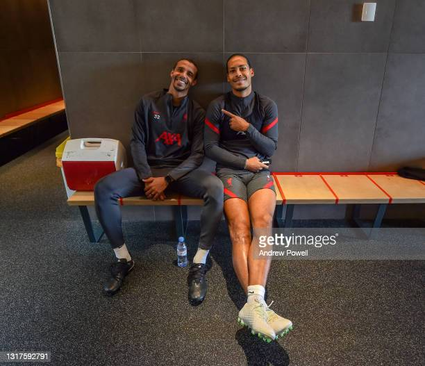 Virgil van Dijk of Liverpool with Joel Matip of Liverpool before a rehabilitation training session at AXA Training Centre on May 12, 2021 in Kirkby,...