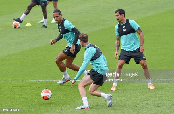 Virgil van Dijk of Liverpool with Jordan Henderson captain of Liverpool and Dejan Lovren of Liverpool during a training session at Melwood Training...