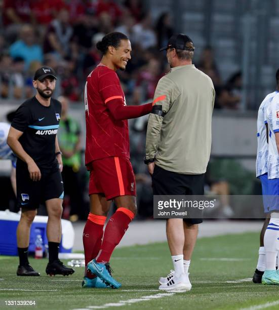 Virgil van Dijk of Liverpool with Jurgen Klopp manager of Liverpool as he comes onto the pitch for the first time after his injury during the Pre...