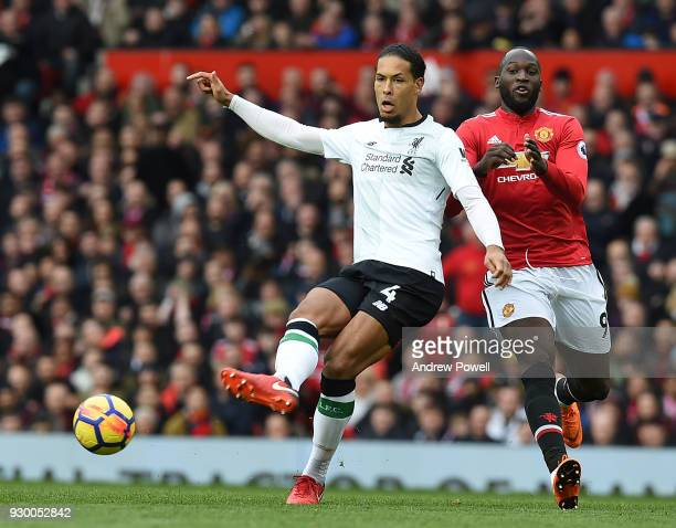 Virgil van Dijk of Liverpool with Romelu Lukaku of Man Utd during the Premier League match between Manchester United and Liverpool at Old Trafford on...
