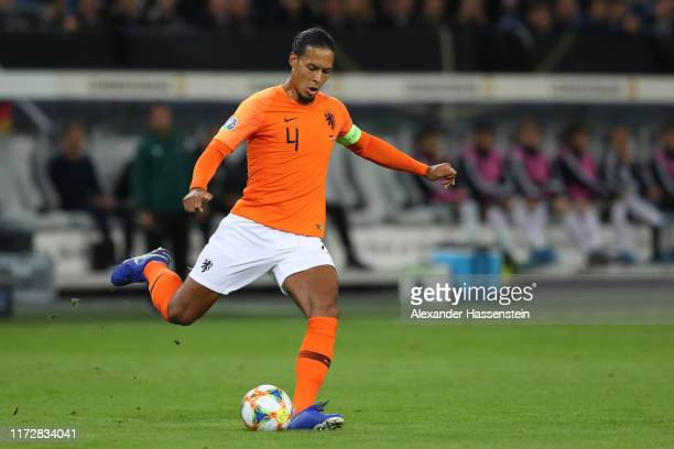 Virgil Van Dijk of Netherlands runs with the ball during the UEFA Euro 2020 qualifier match between Germany and Netherlands at Volksparkstadion on...