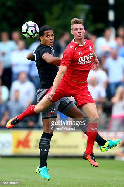 Virgil van Dijk of Southampton and Jari Osterwijk of Enschede go up for a header during the friendly match between Twente Enschede and FC Southampton...