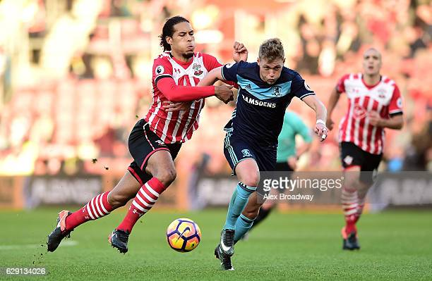 Virgil van Dijk of Southampton and Viktor Fischer of Middlesbrough battle for the ball during the Premier League match between Southampton and...