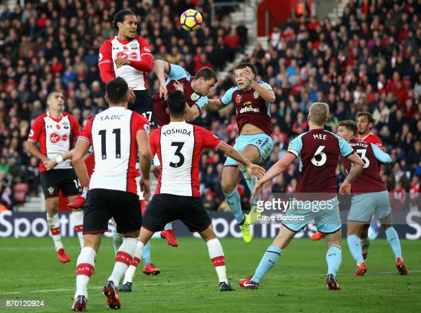 Virgil van Dijk of Southampton beats Burnley players to a header during the Premier League match between Southampton and Burnley at St Mary's Stadium...