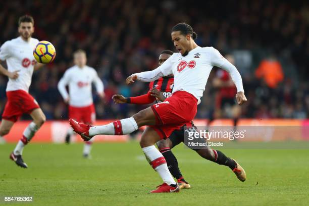 Virgil van Dijk of Southampton clears the ball while under pressure from Jermain Defoe of AFC Bournemouth during the Premier League match between AFC...