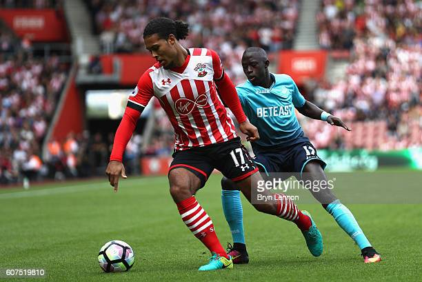 Virgil van Dijk of Southampton is put under pressure from Modou Barrow of Swansea City during the Premier League match between Southampton and...