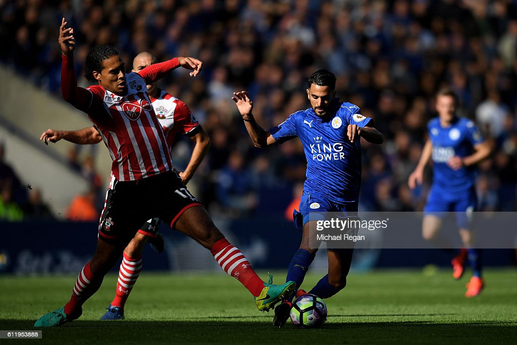 Virgil van Dijk of Southampton (L) tackles Riyad Mahrez of Leicester City (R) during the Premier League match between Leicester City and Southampton at The King Power Stadium on October 2, 2016 in Leicester, England.
