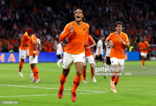 Virgil Van Dijk of the Netherlands celebrates after scoring his team's first goal during the UEFA Nations League A group one match between...