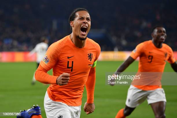 Virgil van Dijk of the Netherlands celebrates with team mate Steven Bergwijn after scoring their team's second goal during the UEFA Nations League A...