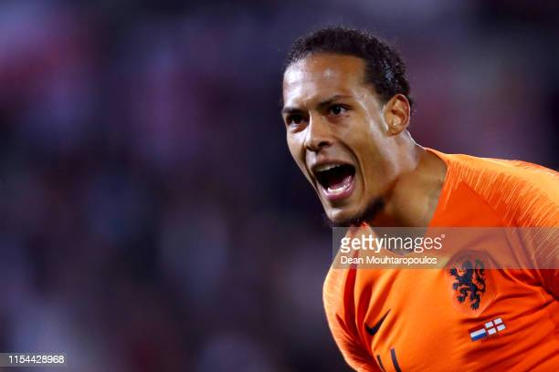 Virgil van Dijk of The Netherlands reacts to the goal scored by Quincy Promes during the UEFA Nations League SemiFinal match between the Netherlands...