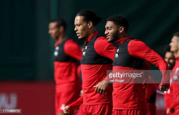 Virgil van Dijk speaks to Joe Gomez of Liverpool during the Liverpool FC training session on the eve of the UEFA Champions League match between SSC...