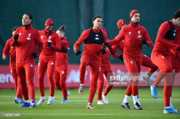 Virgil van Dijk Trent AlexanderArnold Jordan Henderson of Liverpool and their team mates participate in a training session ahead of their UEFA...